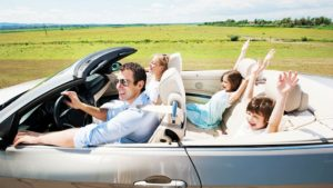 Image of family driving in car