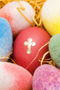 Image of coloured easter eggs with a gold cross